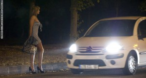 A prostitute waiting for customers stands on the sidewalk late on June 6, 2011 at the Bois de Boulogne park in Paris. AFP PHOTO / BERTRAND LANGLOIS (Photo credit should read BERTRAND LANGLOIS/AFP/Getty Images)
