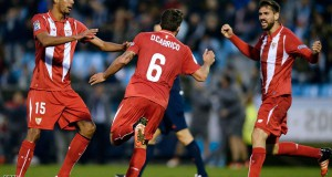 Sevilla's Portuguese midfielder Daniel Carrico (C) celebrates a goal with teammates French midfielder Steven N'Zonzi (L) and forward Fernando Llorente during the Spanish league football match RC Celta de Vigo vs Sevilla FC at the Balaidos stadium in Vigo on February 7, 2016. AFP PHOTO / MIGUEL RIOPA / AFP / MIGUEL RIOPA        (Photo credit should read MIGUEL RIOPA/AFP/Getty Images)