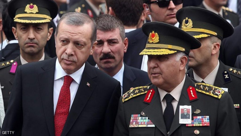 Turkish President Recep Tayyip Erdogan (L) and Turkish officials attend a funeral ceremony for late former army commander Dogan Gures at the Kocatepe Mosque in Ankara, Turkey, Oct. 16, 2014.  Gures died in Ankara on October 14. AFP PHOTO/ADEM ALTAN        (Photo credit should read ADEM ALTAN/AFP/Getty Images)