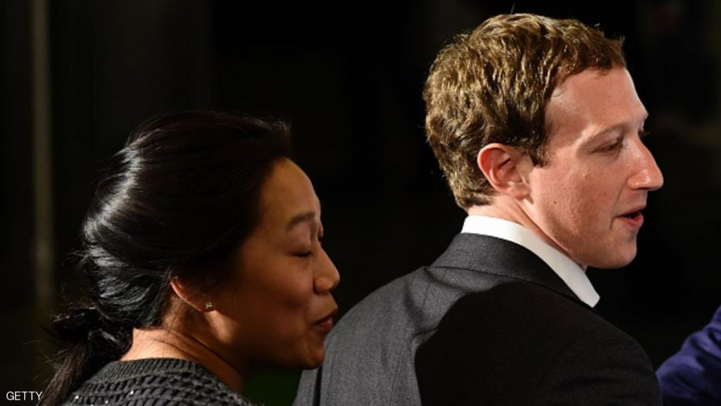 Facebook founder and CEO Mark Zuckerberg (R) arrives to receive the Axel Springer Award with his wife Priscilla Chan in Berlin on February 25, 2016. Facebook announced it was donating computer servers to a number of research institutions across Europe, starting with Germany, to accelerate research efforts in artificial intelligence (AI) and machine learning. / AFP / John MACDOUGALL (Photo credit should read JOHN MACDOUGALL/AFP/Getty Images)